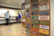Some of Allen's license plate collection is on display in the county treasurer's office at the Douglas County Courthouse, where residents take care of their vehicle taxes and tags.