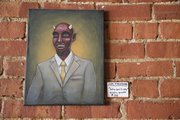 """Satan Goes to College,"" a painting by Colby Earleywine hangs inside Papa Keno&squot;s Pizzeria, 1035 Massachusetts St. The restaurant displays work by budding local artists, who have made some sales through exposure there."