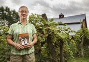 "Joy Lominska holds her newly published book, ""The Old Home Place, The Story of a Kansas Farm,"" outside her family farm in rural southern Jefferson County, Saturday, Aug. 3, 2013. The book details the farm&squot;s history dating back more than 100 years."