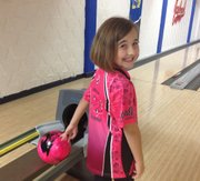 Nine-year-old Natalie Savant has a goal to bowl in each of the 48 contiguous states as a way to raise money and awareness for youth bowling. Monday Savant stopped in Lawrence to bowl at Kansas University's Jaybowl.