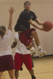 "The Jayhawk Health Initiative hosed a 3-on-3 basketball tourney called ""Hoops for Health"" to raise funds for a medical mission trip. Pictured, high-flying Sean Wickliffe, 23, of Lawrence, skies for two points, during the tournament held at Ambler Student Recreation Fitness Center."