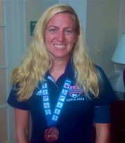 Lawrence resident Lindsay Lorenz wears her bronze medal from the 2013 Deaflympics July 27 through Aug. 7 in Bulgaria. Lorenz won the coveted prize in the 1,000-meter cycling sprints.