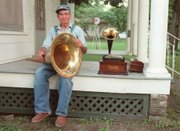 """Floyd Sutton, photographed in 1999. His collection of antique record players are on display at the Blue Rapids Museum as """"Fib&squot;s Collection of Record Proportions: 94 Years in the Making."""""""