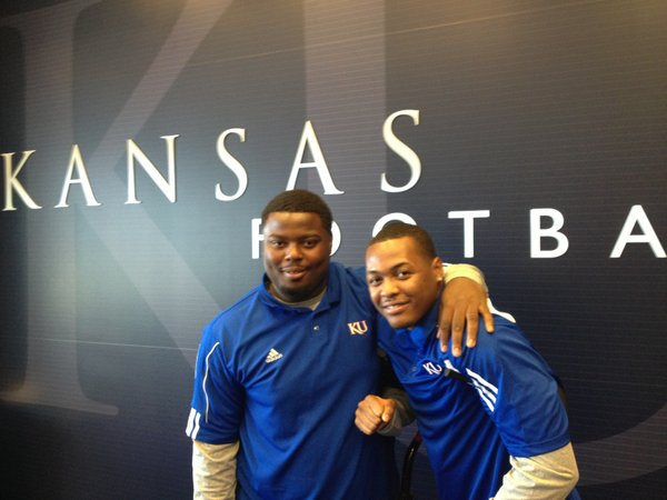 Kansas University defensive tackle Marquel Combs, left, and linebacker Marcus Jenkins-Moore, juco teammates at Pierce College, are leaning on each other in their first season at KU. The pair hope to reunite on the field next season, when Jenkins-Moore will return from a knee injury.