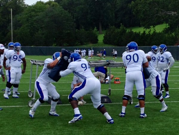 KU's defensive linemen work a leverage drill during Thursday morning's practice.