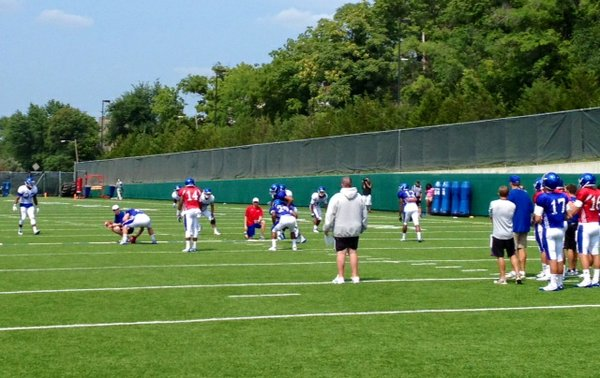 KU coach Charlie Weis watches his offense during seven-on-seven drills at Friday's practice.