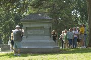 About 40 history buffs boarded a bus in Missouri on Sunday and came to Lawrence for a tour and history lesson on Quantrill's raid. They toured Oak Hill Cemetery and stopped at the memorial of those who lost their lives in the massacre.