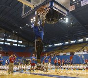 Former Kansas University forward Thomas Robinson, a member of the Portland Trail Blazers, throws down a dunk during a game of J-A-Y as campers watch during the Bill Self basketball camp held Sunday, Aug. 18, 2013, at Allen Fieldhouse.