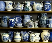 Vintage pitchers line the antique cupboards at Mission Road Antiques Mall.