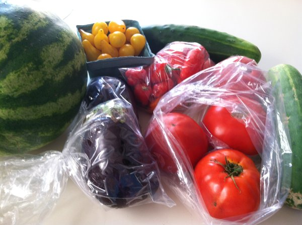 This week's goodies: Two types of tomatoes, cucumbers, eggplant, melon and little sweet peppers.
