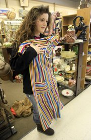 """Kelly Owen looks over a used dress Feb. 26, 2010, at the Lawrence Antique Mall, 830 Massachusetts St. The joy of finding that unique and unexpected """"find"""" amidst a sea of vintage collectibles makes shoppers' hearts beat a little faster. And with so many antique malls and flea markets in the Kansas City metro area to choose from, the thrill of the hunt never ends."""