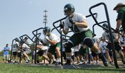 Free State lineman Scott Frantz, right, and other Firebirds players hustle through a drill during the first day of practice on Monday, Aug. 19, 2013 at Free State High School.