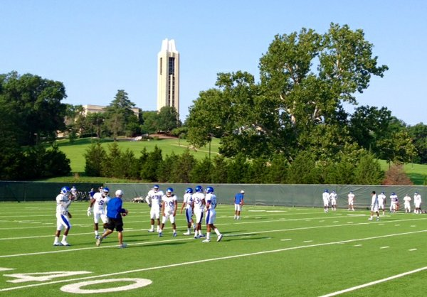 KU assistant Scott Vestal works with the defensive backs during a drill Wednesday morning.