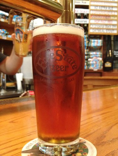 A glass of Phoenix Rising at Free State, a beer the brewery created to commemorate Quantrill's 1863 raid on Lawrence and the city's rebuilding after it.