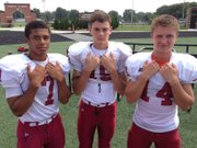 Lawrence High's football team has three quarterbacks vying for the Lions' starting spot. Pictured, from left, are sophomore Alan Clothier, junior Nyle Anderson and senior Tucker Sutter.