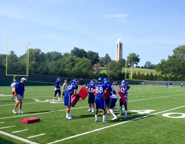 The Kansas wide receivers run through a drill designed to break tackles at Friday morning's practice.