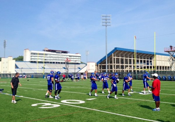 KU's running backs go through drills during Friday morning's practice.