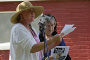 "Laura Routh, left, reads part the ""Declaration of Sentiments"" Saturday as The League of Women Voters held a celebration in South Park to mark the 93rd anniversary of the 19th Amendment, which gave women the right to vote."