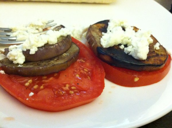 Grilled eggplant with tomato and goat cheese.