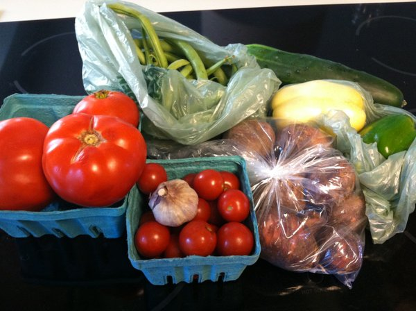 Tomatoes, cucumbers, garlic, green beans, bell peppers and potatoes.