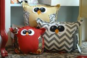 A few of the assorted owl pillows available at Made, 737 Massachusetts St. The pillows are design and handmade by Lawrence resident Kristin Campbell.