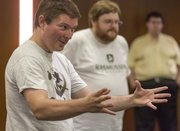 Roving Imps leader John Robison, left, and Chris Hurt perform a skit during a show at Alderson Auditorium in the Kansas Union on Aug. 24, 2013.