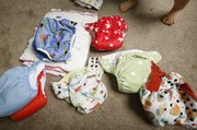 The Williams' have a variety of kinds of cloth diapers that they regularly use, some of which are advantageous for their ease of use and others work better for overnight situations.