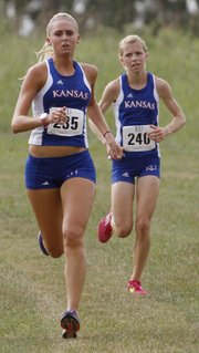 Kansas University freshmen Jennifer Angles, left, and Grace Morgan, finish second and third for the KU women's cross country team in the Bob Timmons Classic, Saturday, Aug. 31, 2013, at Rim Rock Farm.