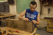 Kansas University graduate student Eli Gold, of Ithaca, New York, spent Labor Day working in the wood shop at the Art and Design building on campus. It would be one of his last opportunities to concentrate on his own projects before he would be busy helping undergraduate students in the fall.