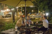 From left Stevie Reiff, Overland Park, Amanda Seurer, KU senior, Abilene, and Dani Costanza, KU senior, Overland Park, have some midnight coffee at The Java Break, 17 E. Seventh St., Friday, August 30, 2013.