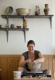 Kara McKamey works on creating a bowl recently at her studio and business at Muddy Waters Studio, 925 Iowa St., Suite J. McKamey will have her works for sale at the 34th Annual Fall Arts and Crafts Show on Sunday from 10 a.m. to 5 p.m. in South Park.