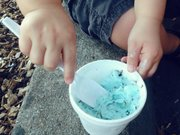 The Kid digs into Cookie Monster ice cream from Sylas and Maddy's, at 1014 Massachusetts St.