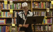 Author Scott Ross reads aloud during an author event at the Raven Book Store, 6 E. Seventh St.