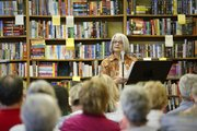 Author Cathy Callen reads to a packed audience on Thursday, Sept. 5, 2013, at The Raven bookstore, 6 E. Seventh St.