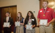 Two seniors from both Lawrence and Free State high schools were recognized Friday at the Community Education Breakfast as Student Champions. From left are Lawrence Chen and Logan Brown of FSHS and Puja Shah and Bryce Montes de Oca of LHS..