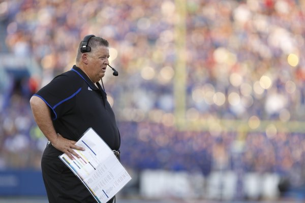 Kansas head coach Charlie Weis watches as a touchdown by Josh Ford is called back during the first quarter against South Dakota on Saturday, Sept. 7, 2013 at Memorial Stadium.