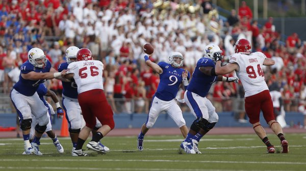 Kansas quarterback Jake Heaps turns to throw against South Dakota during the second quarter on Saturday, Sept. 7, 2013 at Memorial Stadium.