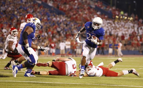 Kansas running back James Sims heads in for a touchdown against South Dakota during the third quarter on Saturday, Sept. 7, 2013 at Memorial Stadium.
