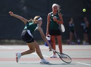 Free State No. 2 singles player Megan McReynolds reaches for a return during her first-round match against Lawrence High's Kendall Pritchard, Tuesday, Sept. 10, 2013 at Lawrence High School.