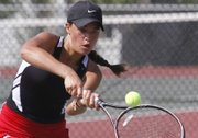 Lawrence High tennis player Brooke Braman competes in her No. 2 doubles match against Blue Valley Northwest, Wednesday, Sept. 11, 2013, at LHS.