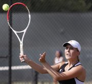 Lawrence High tennis player Zoe Schneider competes in her No. 1 doubles match against Blue Valley Northwest, Wednesday, Sept. 11, 2013, at LHS.