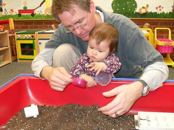 Charlie Bryan and daughter Bella exploring the dirt.