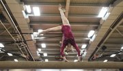 Lawrence High's Allison Williams performs her balance beam routine during LHS' gymnastics meet Thursday at LHS.