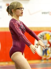 Lawrence High's Ro O'Daniels performs her floor exercise routine during LHS' gymnastics meet Thursday at LHS.