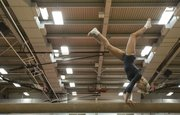 Free State's Haley Johnson performs her balance beam routine during Free State's gymnastics meet Thursday at LHS.