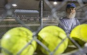 Jim Bateman watches from the dugout during a softball game Thursday, Sept. 12, 2013 at the Clinton Lake Softball Complex.