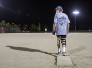 "Wearing his ""Just Hafta Play Softball"" shirt, Jim Bateman leads off first base during a softball game Thursday, Sept. 12. 2013 at the Clinton Lake Softball Complex."
