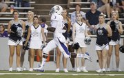 Kansas running back Tony Pierson darts up the sideline for a touchdown past the Rice cheerleaders during the second quarter on Saturday, Sept. 14, 2013 at Rice Stadium in Houston, Texas.