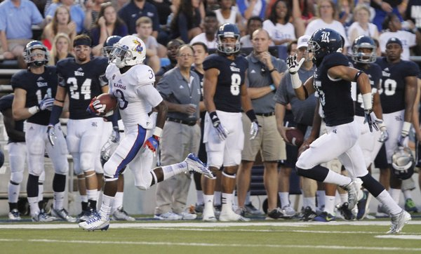 Kansas running back Tony Pierson leaves Rice cornerback Phillip Gaines in his wake as he races up the sideline for a touchdown during the second quarter on Saturday, Sept. 14, 2013 at Rice Stadium in Houston, Texas.