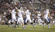 Kansas quarterback Jake Heaps throws to the sideline against Rice late in the fourth quarter on Saturday, Sept. 14, 2013 at Rice Stadium in Houston, Texas.
